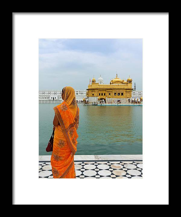 Indian Subcontinent Ethnicity Framed Print featuring the photograph Pilgrim In Golden Temple Amritsar, India by Prognone