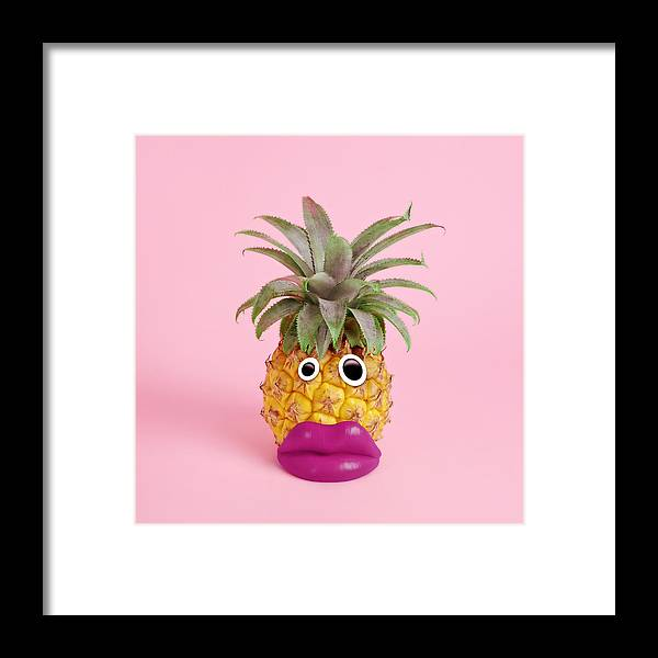 Googly Eyes Framed Print featuring the photograph Pineapple With Face Made Of Fake Lips by Juj Winn