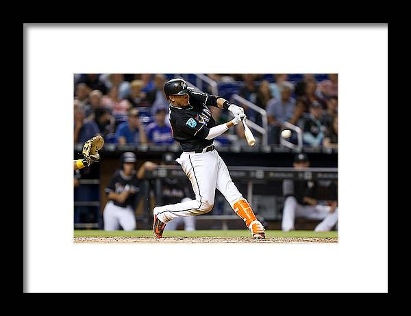 People Framed Print featuring the photograph Pittsburgh Pirates v Miami Marlins by Michael Reaves