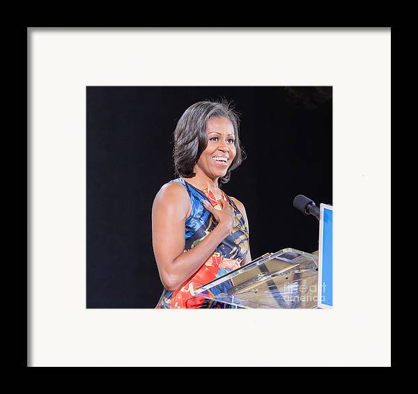 Michelle Obama Framed Print featuring the photograph Political Ralley by Ava Reaves