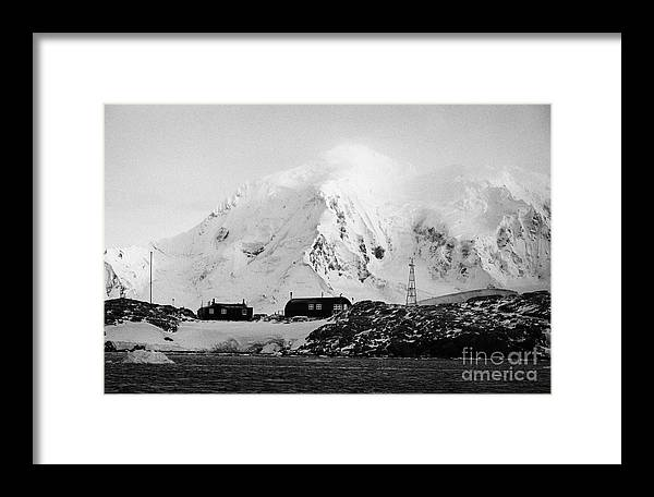 Port Framed Print featuring the photograph port lockroy british Antarctica trust base museum with anvers island in the background by Joe Fox