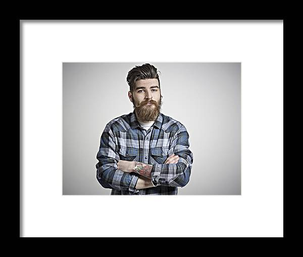 Plaid Shirt Framed Print featuring the photograph Portrait of man with beard, tattoos & check shirt. by Mike Harrington