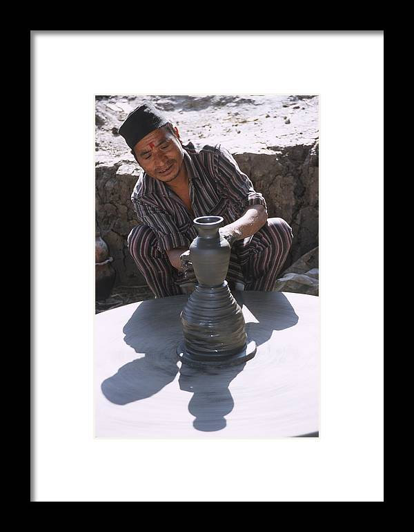 Nepal Framed Print featuring the photograph Potter At Work In Bhaktapur by Richard Berry