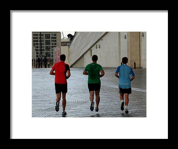 Men Framed Print featuring the photograph Pounding The Street by Susan Tinsley
