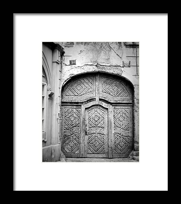 Black And White Framed Print featuring the photograph Prague Doorway by Todd Hartzo