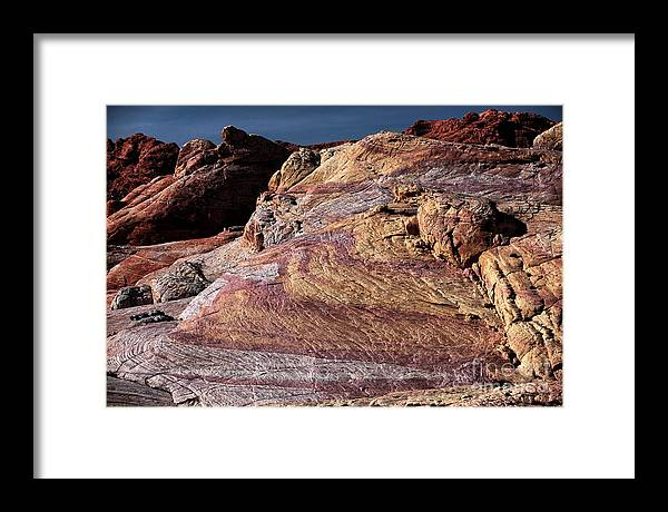 Purple Rocks Framed Print featuring the photograph Purple Rocks by John Rizzuto