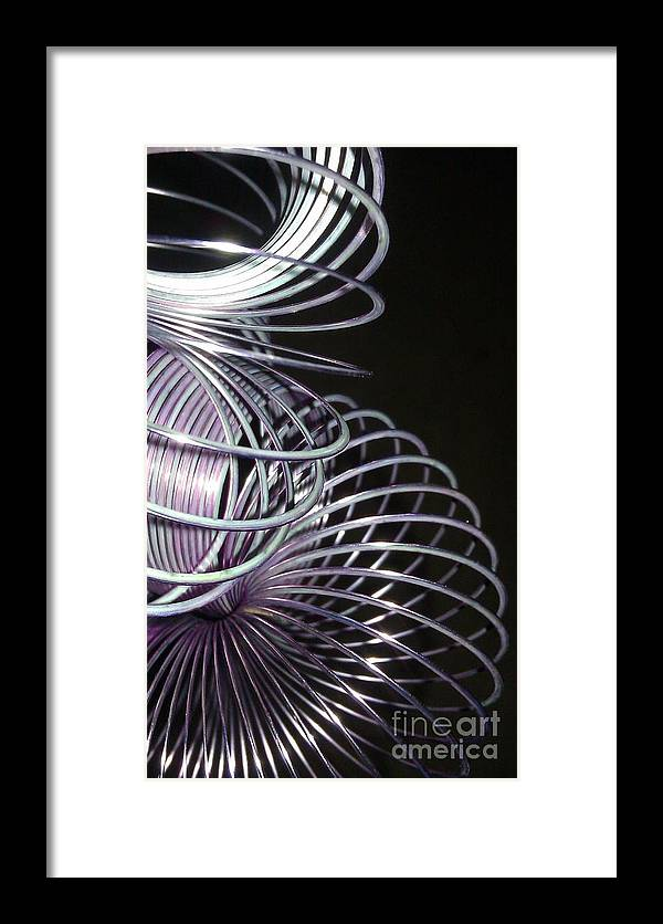 Slinky Framed Print featuring the photograph Purple Slinky by Paulina Roybal