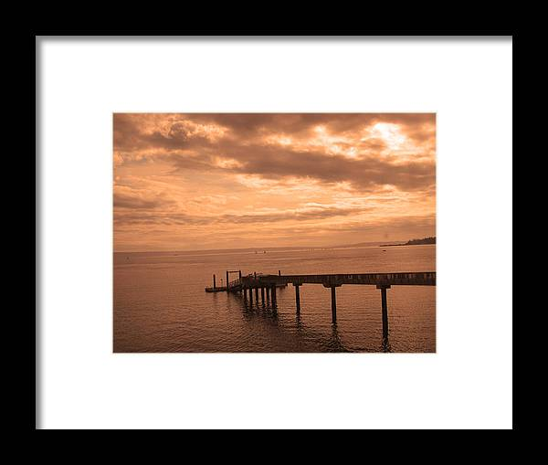Washington Pier Framed Print featuring the photograph Quiet Peachy Toned Pier by Kym Backland