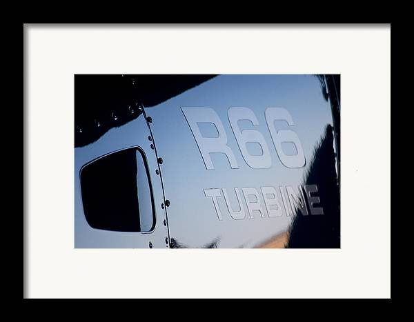 Robinson's R66 Turbine Helicopter Framed Print featuring the photograph R66 Reflection by Paul Job