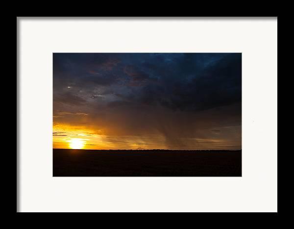 Rain Framed Print featuring the photograph Rainy Sunset by Brandon Ivey