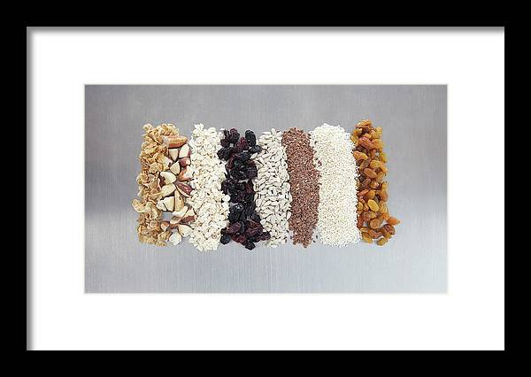 Nut Framed Print featuring the photograph Raw Nuts, Dried Fruit And Grains by Laurie Castelli