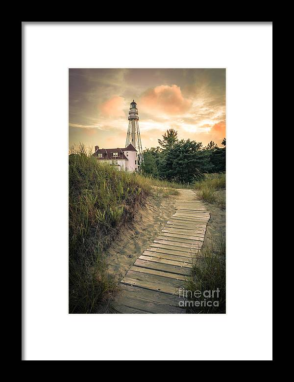 Rawley Point Framed Print featuring the photograph Rawley Point Lighthouse Under Smoldering Skies by Ever-Curious Photography