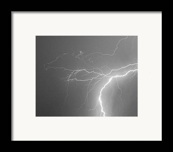 Lightning Framed Print featuring the photograph Reaching Out Touching Me Touching You Bw by James BO Insogna