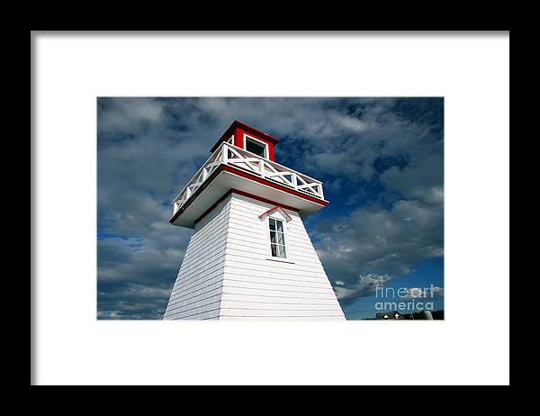 Lighthouse Framed Print featuring the photograph Reaching the Sky by Brenda Giasson