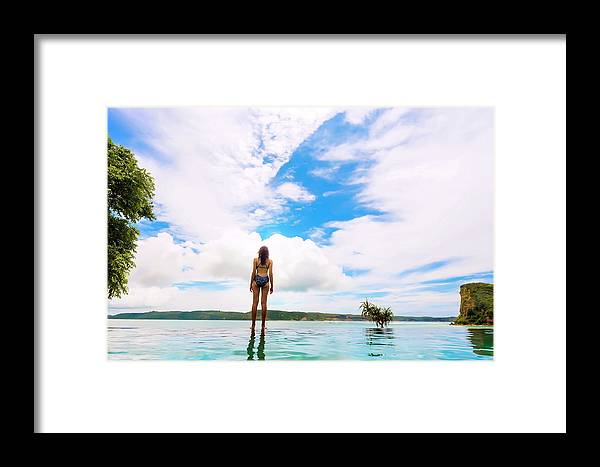Tranquility Framed Print featuring the photograph Rear View Of Woman In Bikini Standing by Konstantin Trubavin