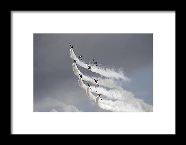 Aerobatics Framed Print featuring the photograph Red Arrows Flying In Formation by Steve Ball