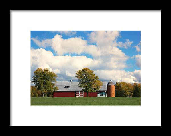 Red Barn Framed Print featuring the photograph Red Barn And Clouds by Wade Crutchfield