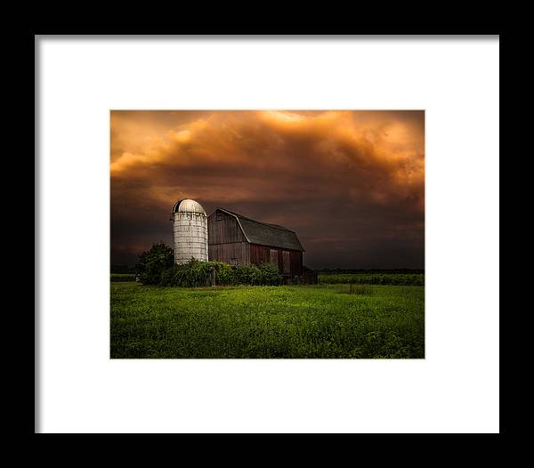 Red Barn Framed Print featuring the photograph Red Barn Stormy Sky - Rustic Dreams by Gary Heller