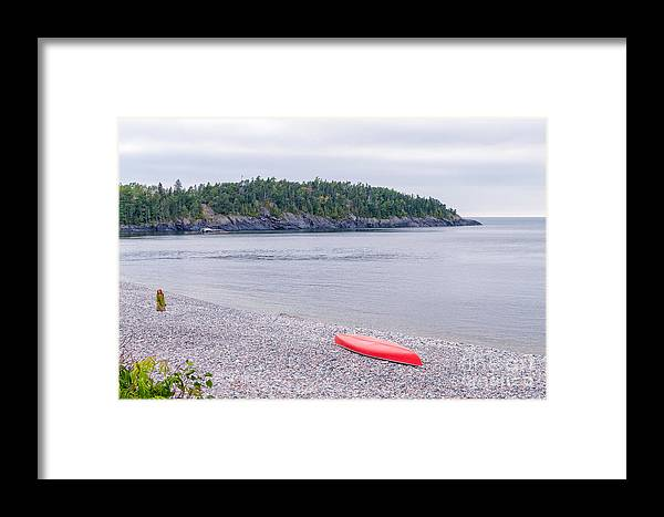 Red Framed Print featuring the photograph Red Canoe And Woman In Green Dress by Les Palenik