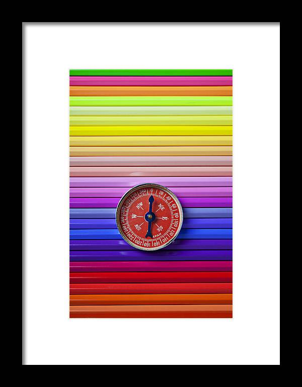 Red Framed Print featuring the photograph Red Compass On Rolls Of Colored Pencils by Garry Gay