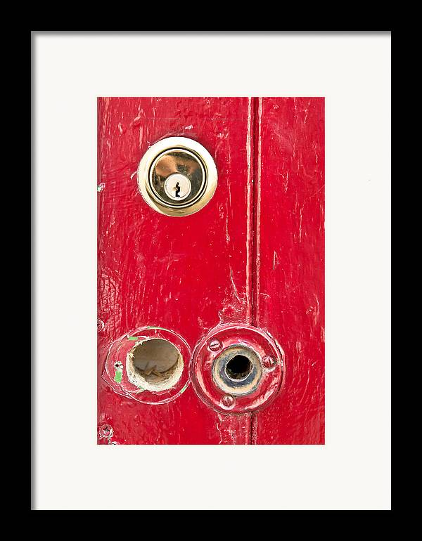 Anti-theft Framed Print featuring the photograph Red Door Lock by Tom Gowanlock