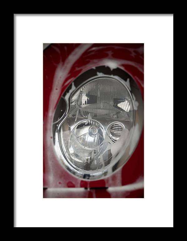 Mini-cooper Framed Print featuring the photograph Red Mini-cooper Car Headlight by Nicole Berna