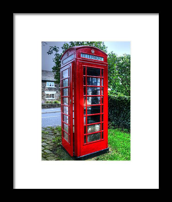 Red Framed Print featuring the photograph Red Telephone Box by Susan Tinsley