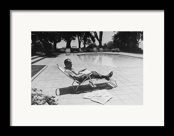 History Framed Print featuring the photograph Richard Nixon Reading Newspapers While by Everett