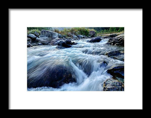 Reshi Framed Print featuring the photograph River Water Flowing Through Rocks At Dawn by Rudra Narayan Mitra
