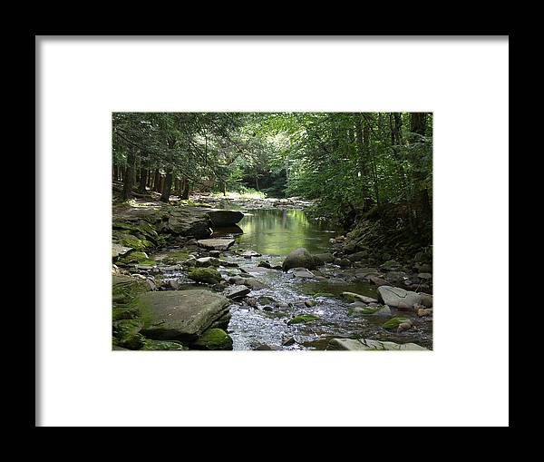 Rocks Framed Print featuring the photograph Riverbed by Karen Kluglein