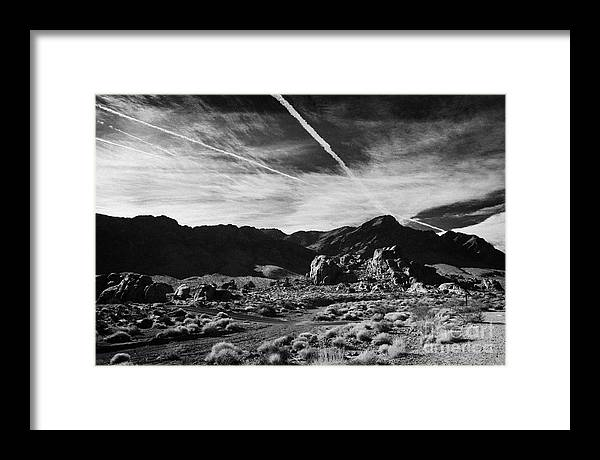 Valley Framed Print featuring the photograph Road Past Sandstone And Limestone Fault Formations In Valley Of Fire State Park Nevada Usa by Joe Fox