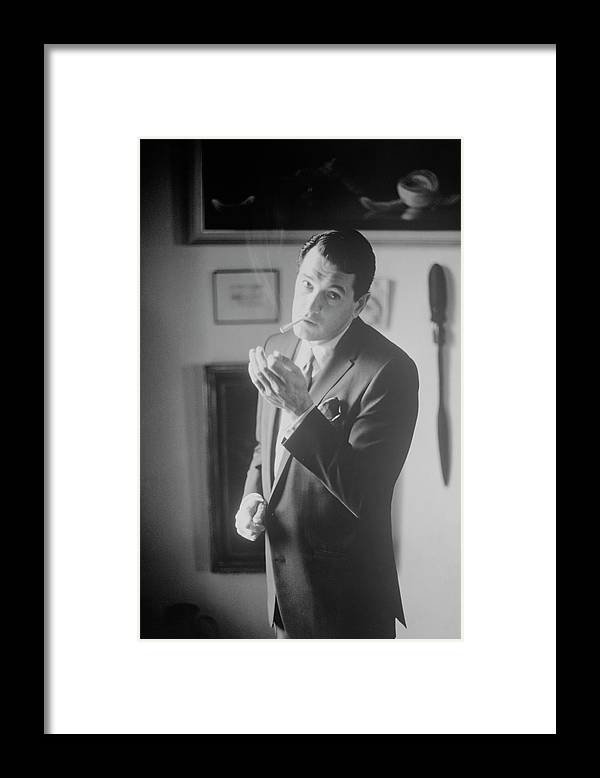 Accessories Framed Print featuring the photograph Rock Hudson Lighting A Cigarette by John Bryson