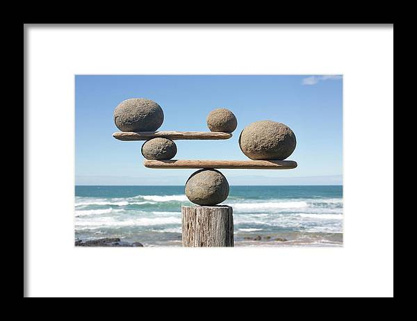 Rocks Balancing On Driftwood Sea In Framed Print By Dimitri Otis