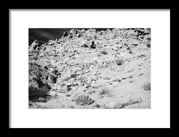 Valley Framed Print featuring the photograph Rocks Forming Support For The Old Arrowhead Trail Road Valley Of Fire State Park Nevada Usa by Joe Fox