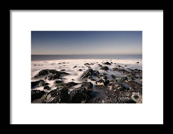 Beach Framed Print featuring the photograph Rocks On The Beach by Tammo Strijker