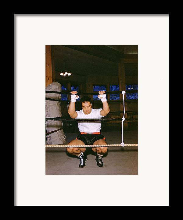 Marvin Newman Framed Print featuring the photograph Rocky Marciano Stretching by Retro Images Archive