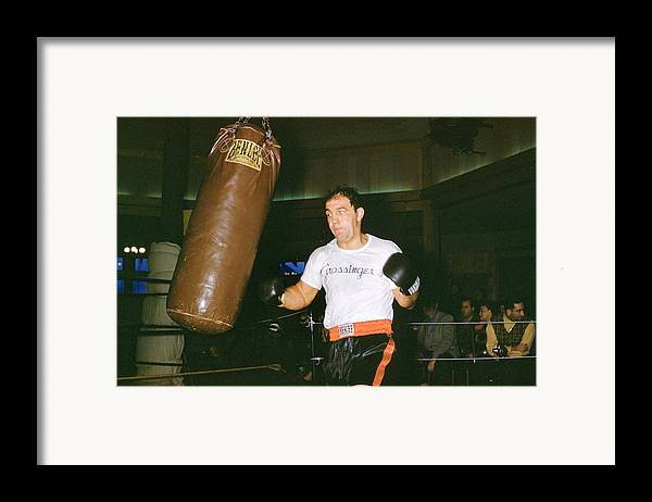 Marvin Newman Framed Print featuring the photograph Rocky Marciano Working Heavy Bag by Retro Images Archive