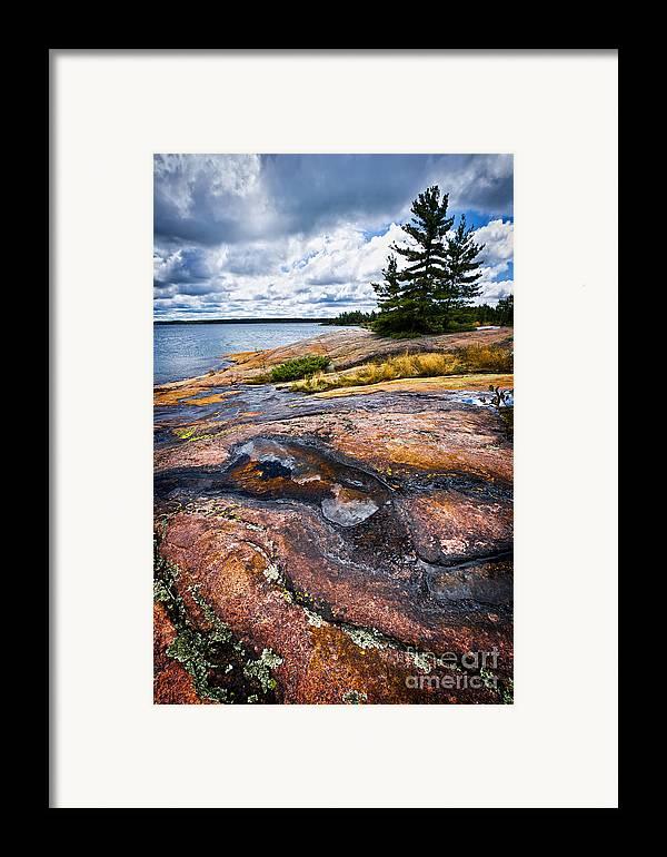 Georgian Framed Print featuring the photograph Rocky Shore Of Georgian Bay by Elena Elisseeva