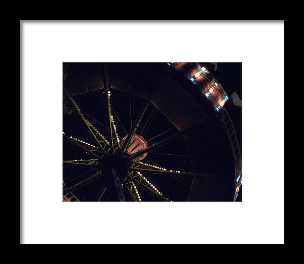 Ride Framed Print featuring the photograph Round And Round by Lois Johnson