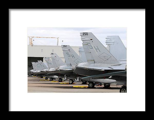 Marine Corps Air Station Miramar Framed Print featuring the photograph Row Of U.s. Marine Corps Fa-18 Hornet by Riccardo Niccoli
