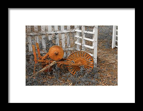 Rusty Framed Print featuring the photograph Rusty Relic by PMG Images