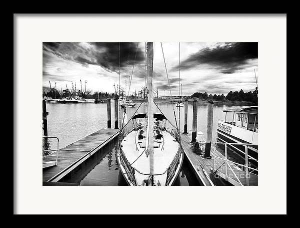Sailboat Docked Framed Print featuring the photograph Sailboat Docked by John Rizzuto