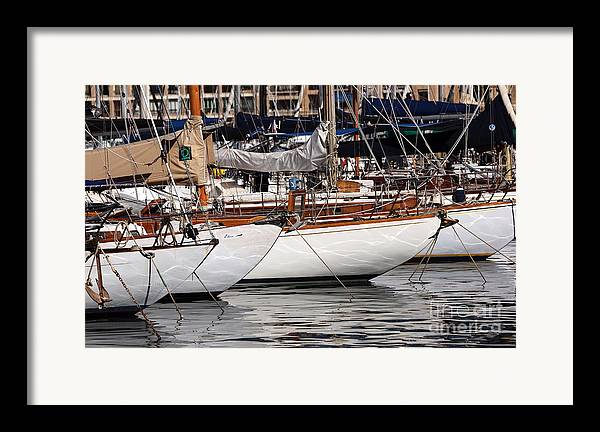 Sailboat Hulls In The Port Framed Print featuring the photograph Sailboat Hulls In The Port by John Rizzuto