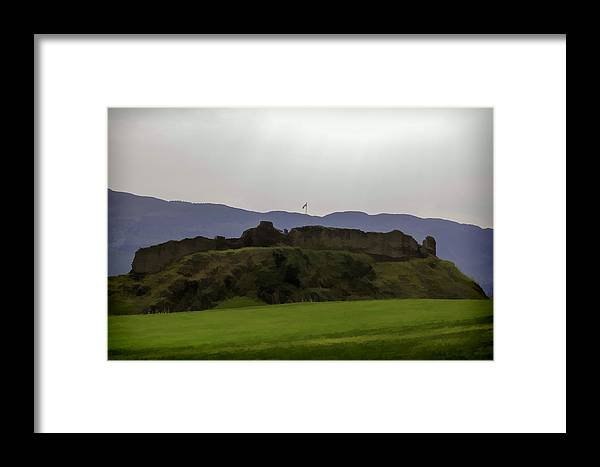 Blue Sky Framed Print featuring the digital art Saltire And The Ruins Of The Urquhart Castle In Scotland At A He by Ashish Agarwal