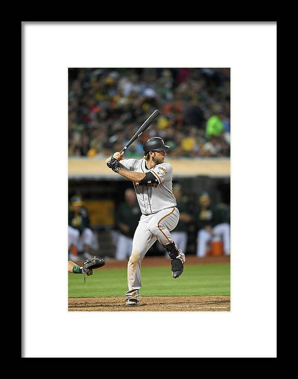 People Framed Print featuring the photograph San Francisco Giants V Oakland Athletics by Thearon W. Henderson