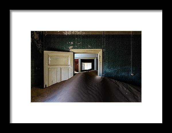 Sand Dune Framed Print featuring the photograph Sand Dune In Door Frame Of Abandoned by Pixelchrome Inc