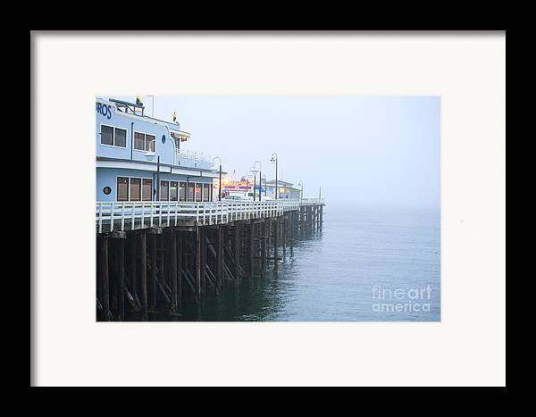 Santa Cruz Pier Framed Print featuring the photograph Santa Cruz Pier In The Fog by Artist and Photographer Laura Wrede