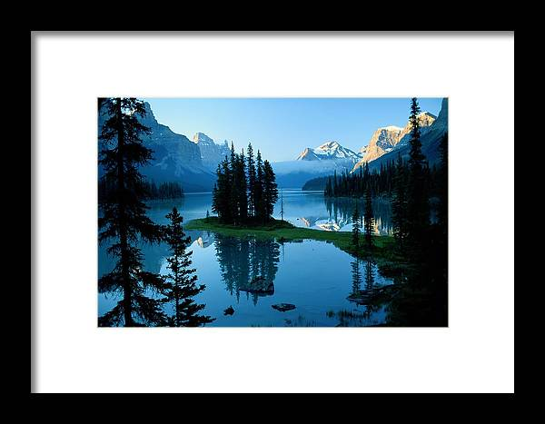 Color Image Framed Print featuring the photograph Scenic View Of Maligne Lake In Jasper by Raymond Gehman