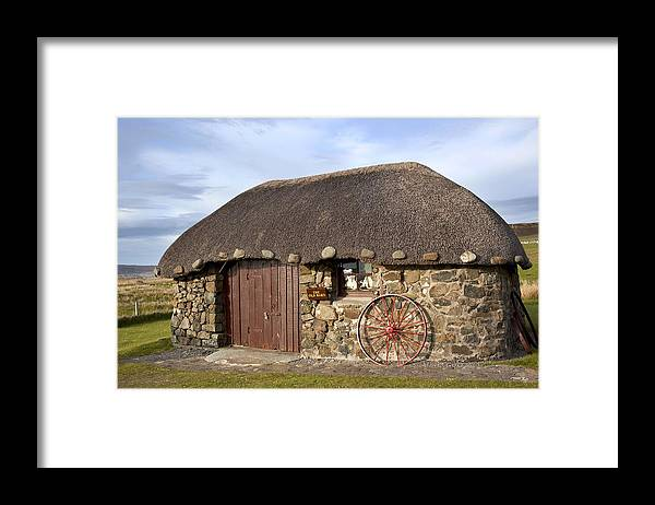 Blue Framed Print featuring the photograph Scottish Thatched Cottage by Georgi Djadjarov