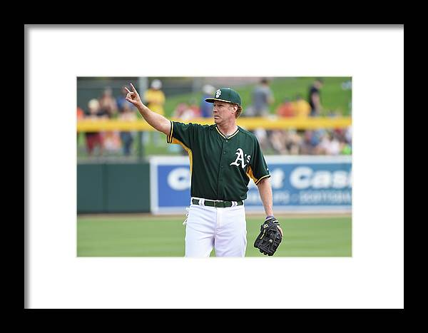 Event Framed Print featuring the photograph Seattle Mariners V Oakland Athletics by Lisa Blumenfeld
